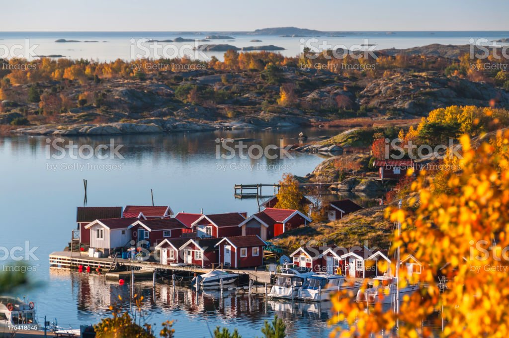 Island in fall. Horizon over water stock photo