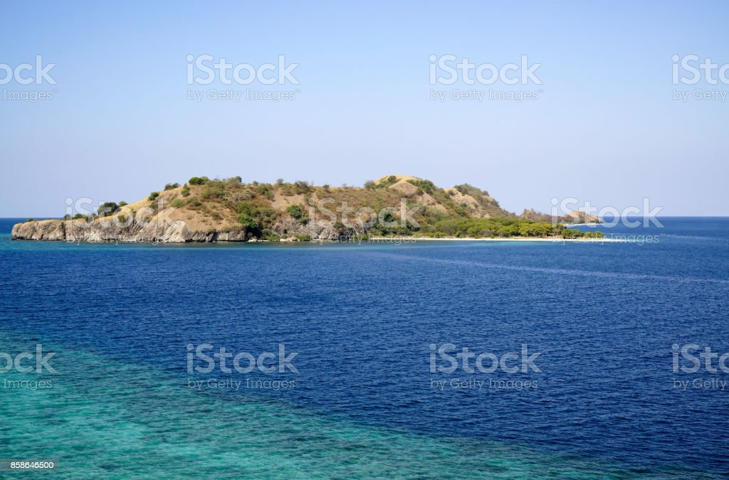Island in the blue ocean at Labuan Bajo, Flores. stock photo