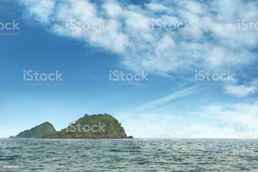 Island in the middle of ocean stock photo
