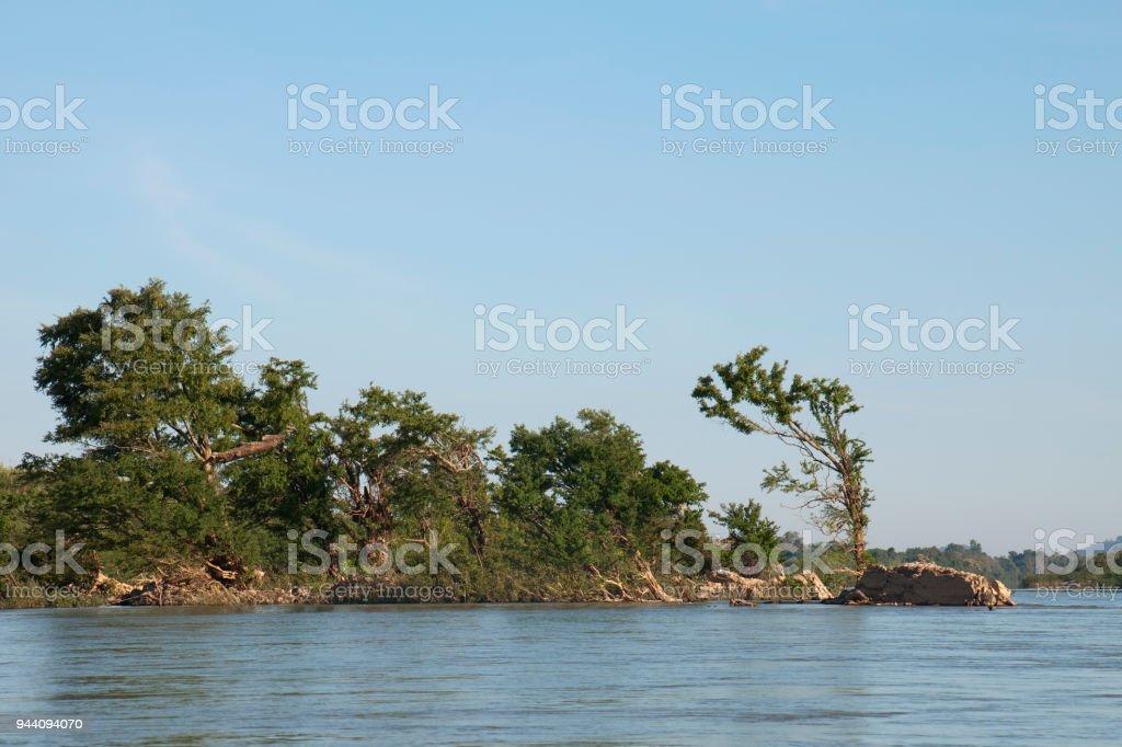 Island mid-stream in the Mekong river near  Preah Rumkel stock photo