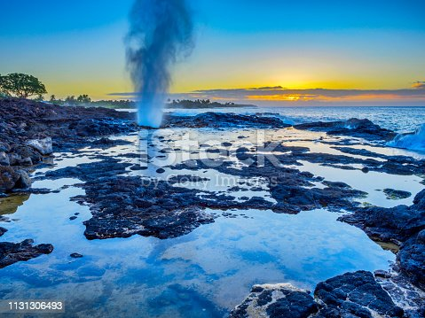 Spouting Horn blow hole at sunrise on the Island of Kauai