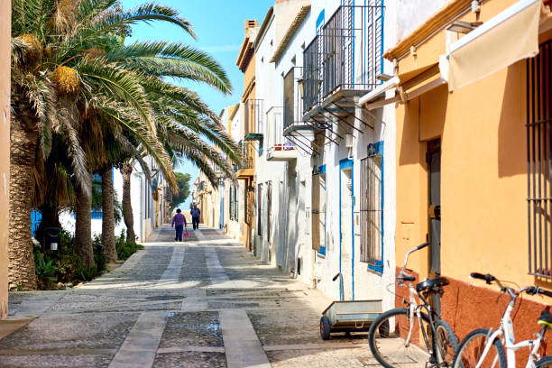 Island of Tabarca Tabarca Island: Charming narrow street in the Island of Tabarca. Province of Alicante. Spain southern charm stock pictures, royalty-free photos & images