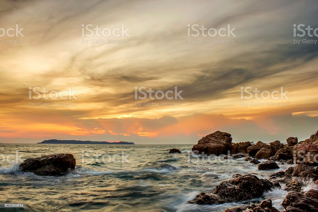 Island sea rock beach with twilight sunset sky landscape stock photo