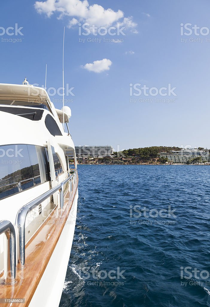 Island shore seen from the luxury Yacht. Summer. royalty-free stock photo