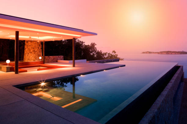 Island Villa Luxury Island Home With Infinity Pool At Dusk. villa stock pictures, royalty-free photos & images