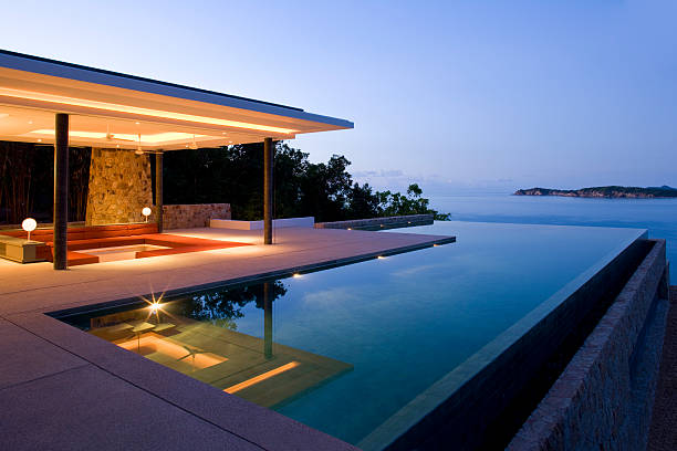Island Villa  infinity pool stock pictures, royalty-free photos & images