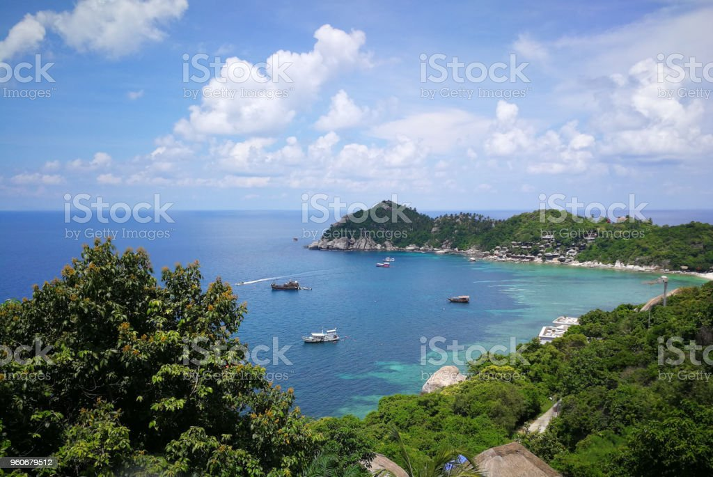 Island with boat on sea in morning time. stock photo