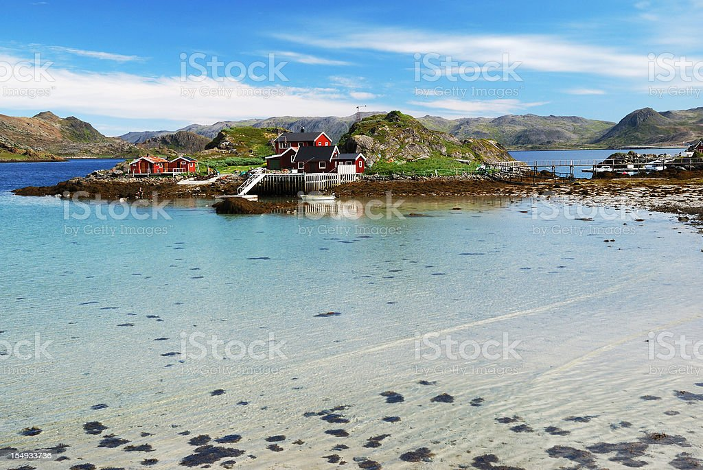 Island with fishing village in the middle of fjord, Mageroya. stock photo