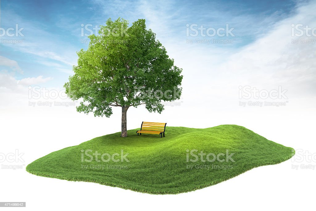 island with tree and bench floating in the air stock photo