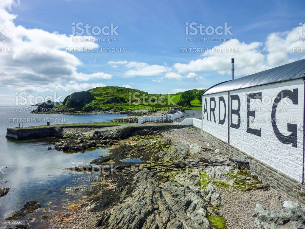 Islay, Scotland - Sseptember 11 2015: The sun shines on Ardbeg distillery warehouse stock photo