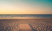 Isle of Re beaches at sunrise with a very calm sea. beautiful minimalist seascape. vintage tones