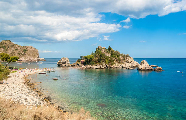 isola bella, in taormina (sicily), during the summer - taormina stock-fotos und bilder