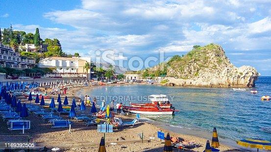 Tourists sunbathing on the beach of Isola Bella island near Taormina in Sicily in September 2016