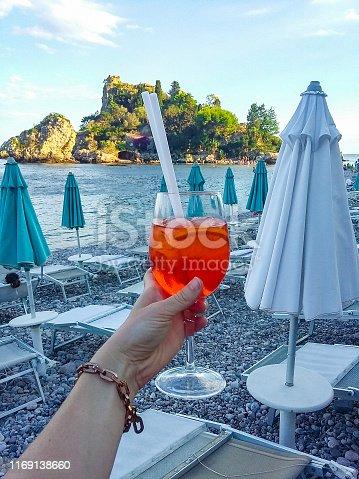 Spritz by Isola Bella island, Taormina, Sicily, Italy