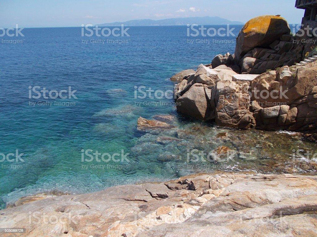 isola del giglio - beach and rock stock photo