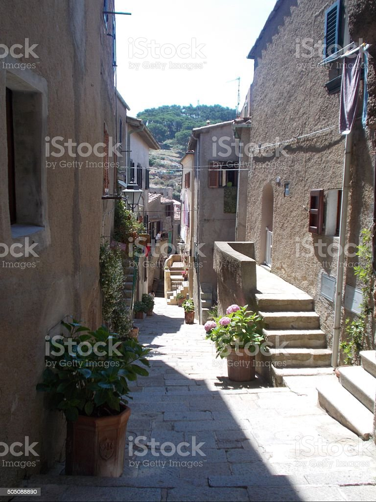 isola del giglio - little street in the old town stock photo