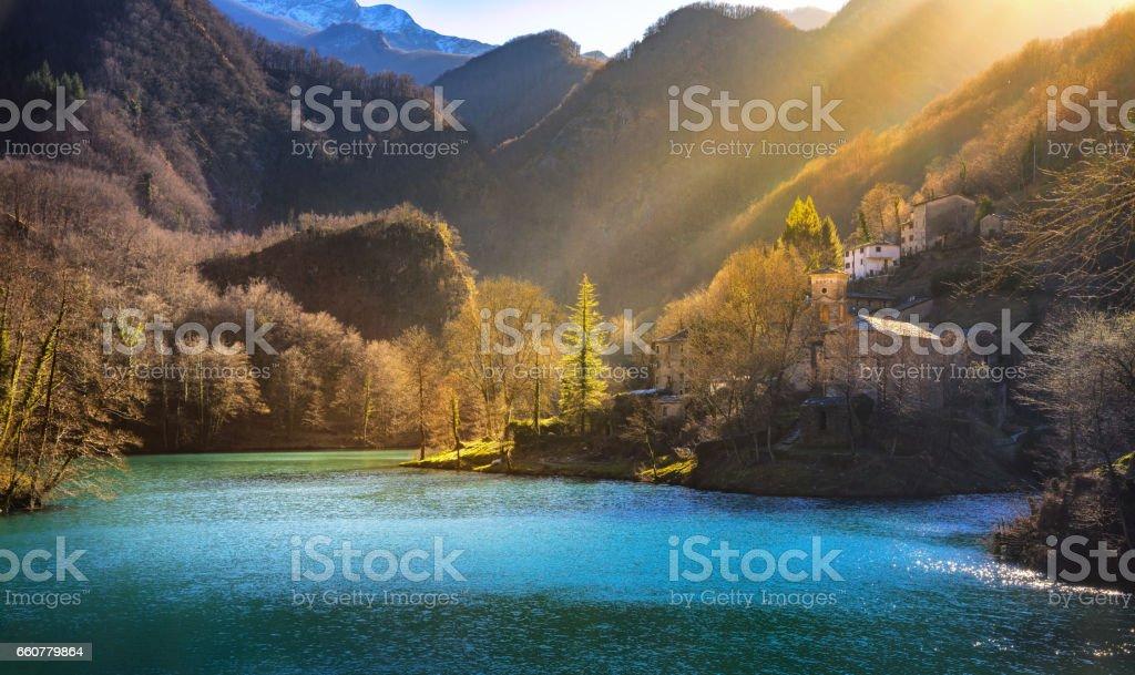 Isola Santa medieval village, church and lake. Garfagnana, Tuscany, Italy. stock photo