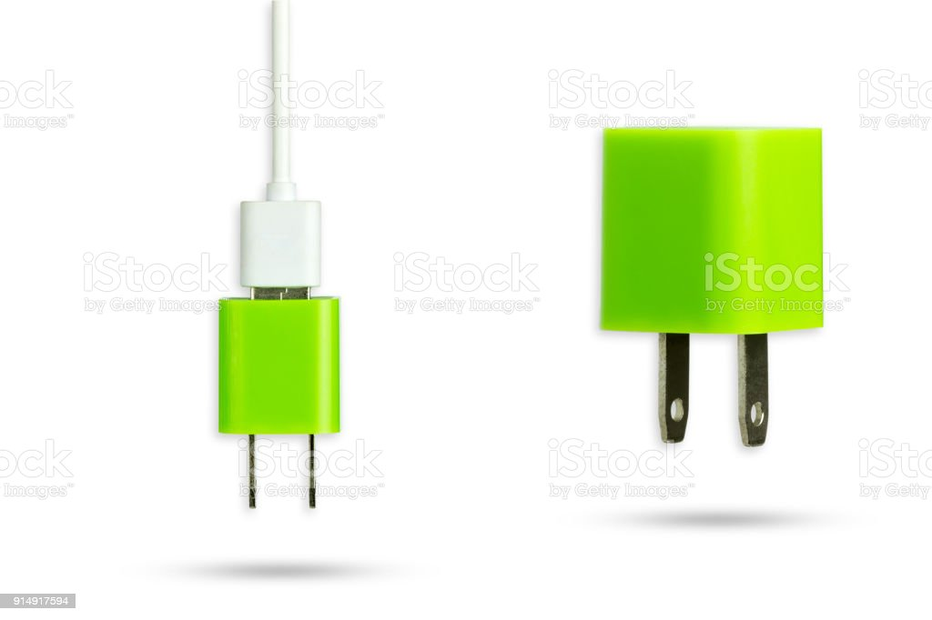 Isolate green adapter charger and usb cable with clipping path. stock photo