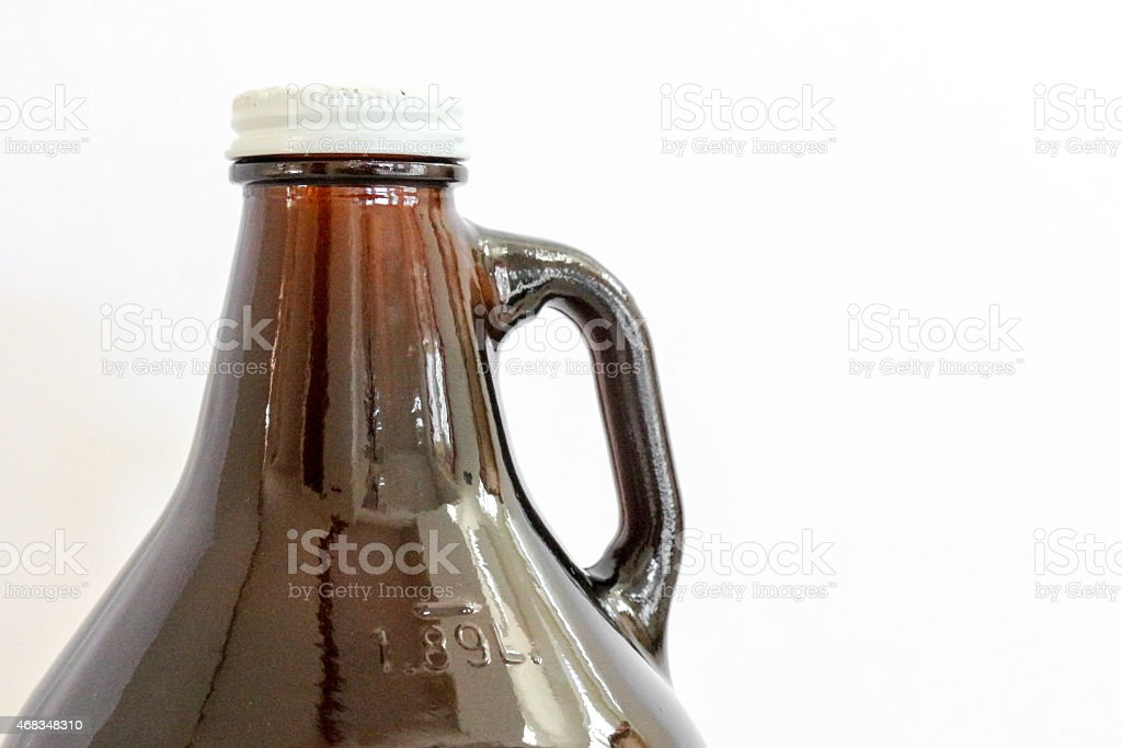 Isolated 1.89 Liter brown beer growler with white cap stock photo