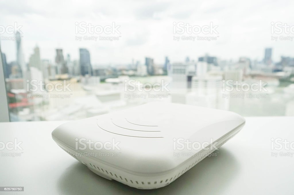 isolated access point on the office desk with city view stock photo
