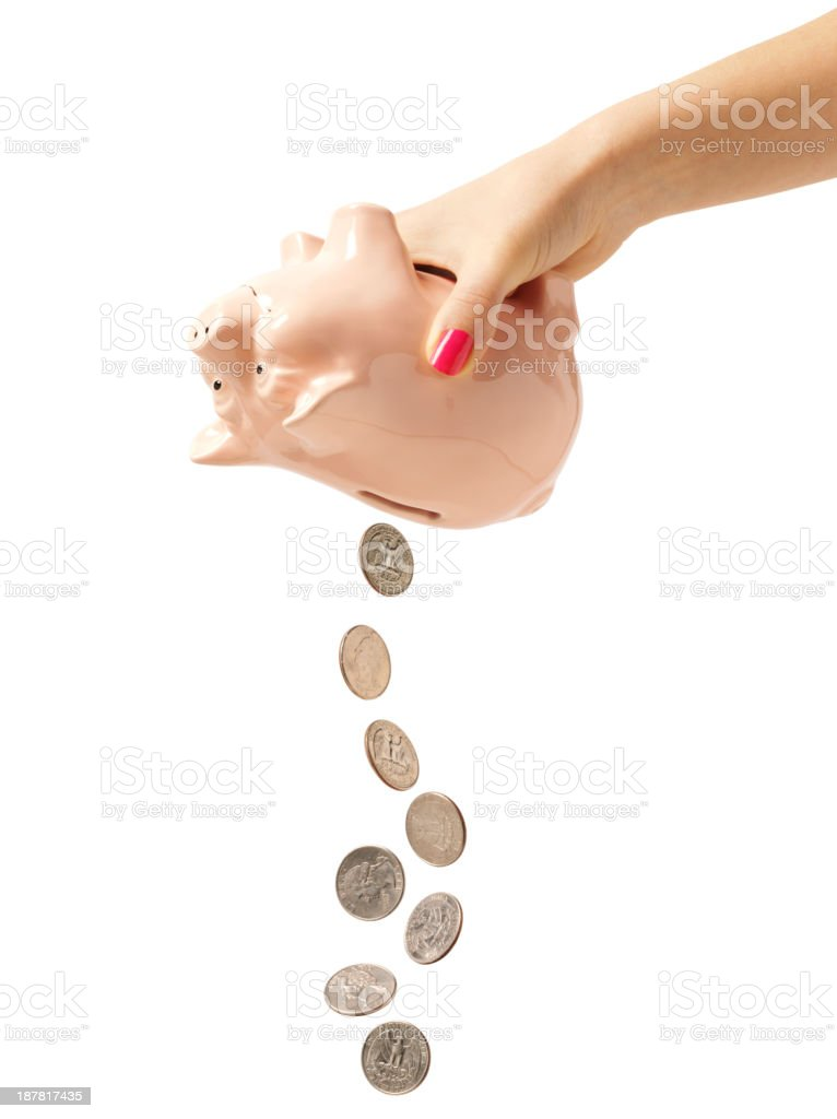 Isolated American Coins falling from a Coin Piggy Bank stock photo