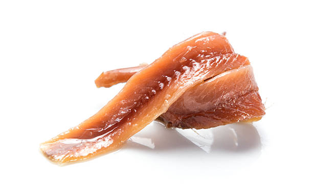 Isolated anchovies Anchovies over withe background anchovy stock pictures, royalty-free photos & images