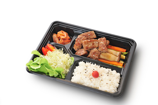 istock Isolated and clipping path of Beef steak set in bento box set. 673840264