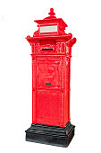 Isolated antique red post mail box on white background.