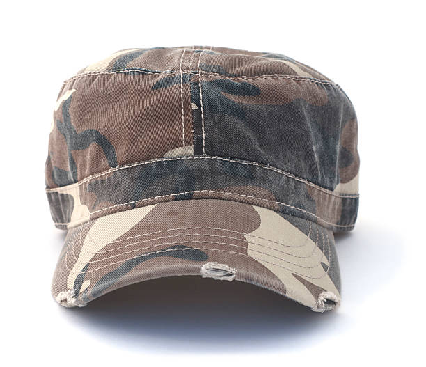 Isolated Army Hat Isolated camouflage army hat on a white background. uniform cap stock pictures, royalty-free photos & images