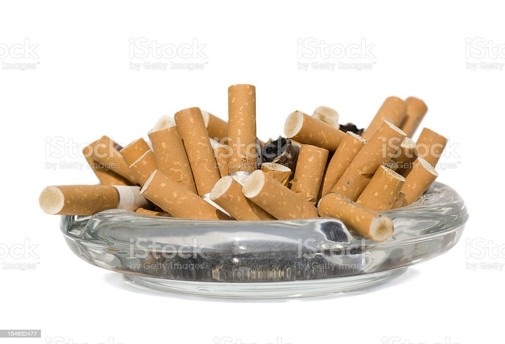 Isolated ashtray with cigarette butts stock photo
