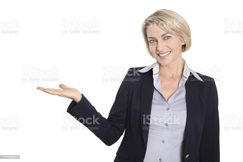 Isolated attractive mature businesswoman is presenting on white. stock photo