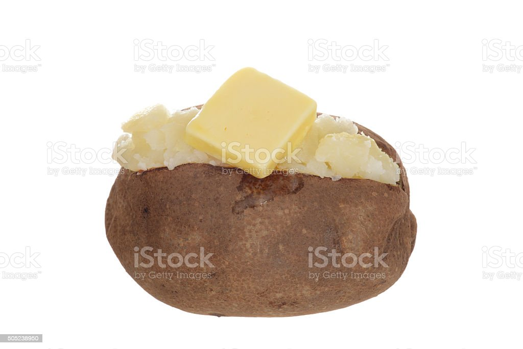 isolated baked potato with butter stock photo