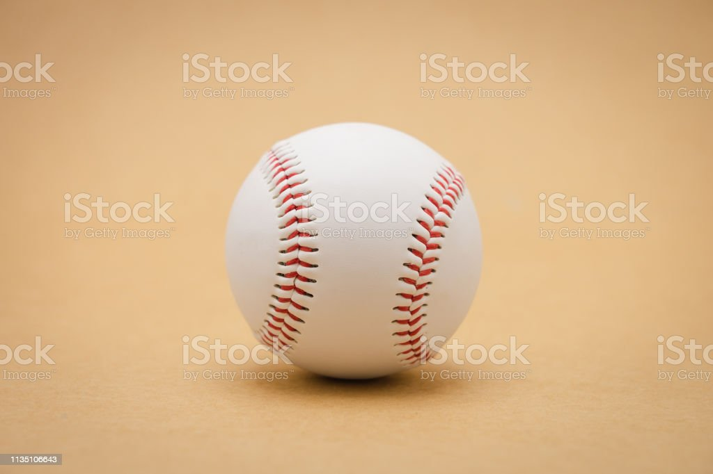 Isolated baseball on a brown background and red stitching baseball....