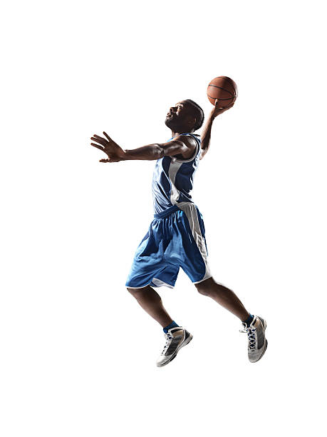 Isolated basketball player Close up image of isolated professional basketball player about to do slam dunk jump shot stock pictures, royalty-free photos & images