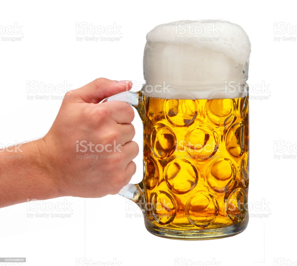 isolated beer mug in hand at Oktoberfest in Munich stock photo