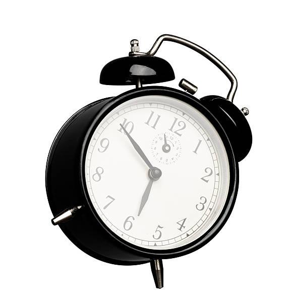 isolated black alarm clock stock photo