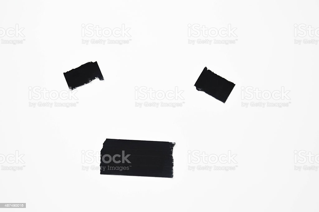 Isolated Black Line Face From Tape stock photo