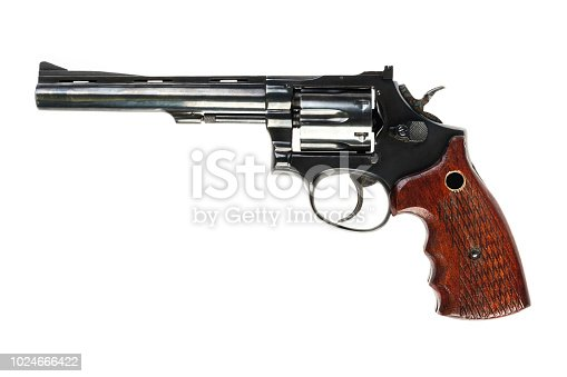 isolated used old black revolver on a white background