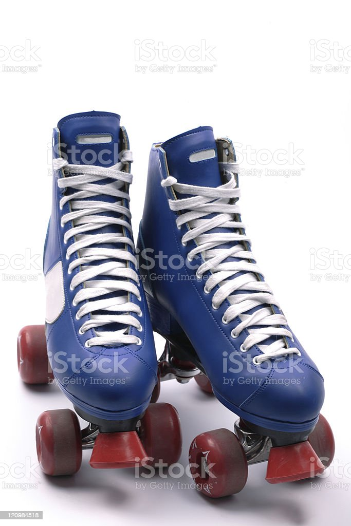 Isolated blue and red roller skates stock photo