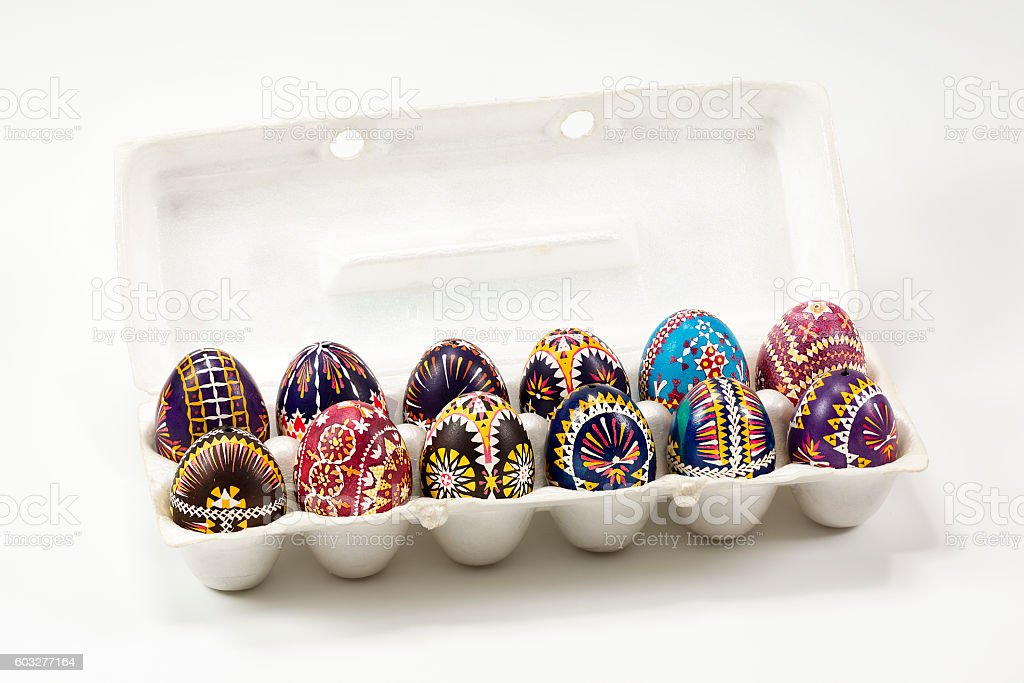 isolated box of Sorbian painted easter eggs on white background stock photo