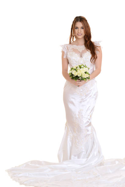 isolated bride standing with bouquet - hochzeitskleider canda stock-fotos und bilder