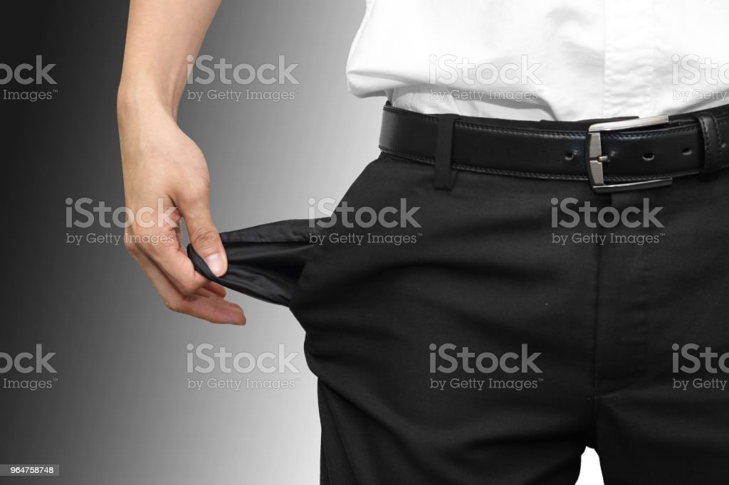 isolated broke man with empty pocket royalty-free stock photo