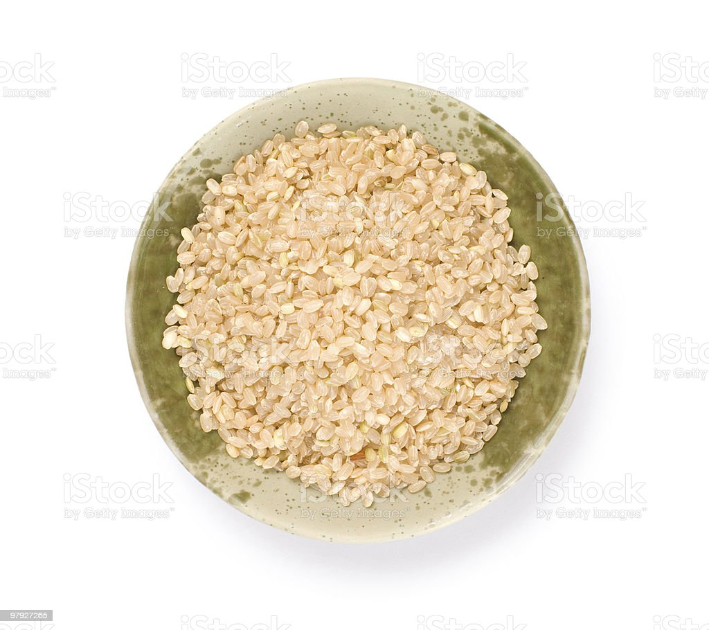 Isolated brown rice in bowl royalty-free stock photo