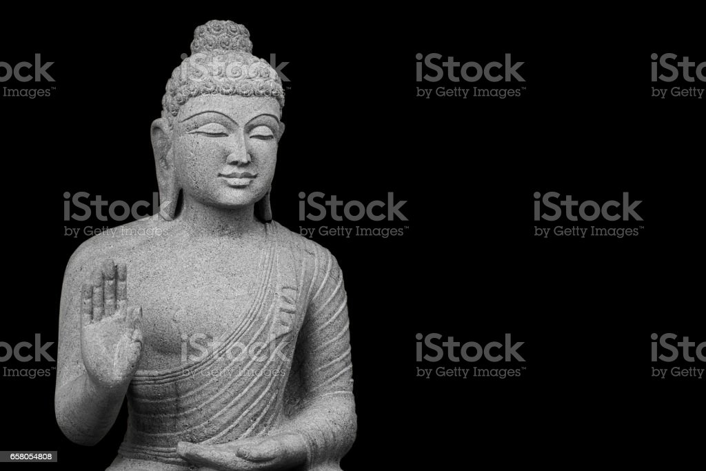 Isolated Buddha Statue with peaceful face with text space stock photo