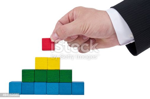 istock Isolated building blocks with hand 494259585