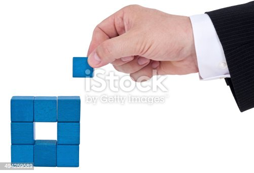 istock Isolated building blocks with hand 494259589