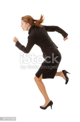 An isolated image of a business woman running.