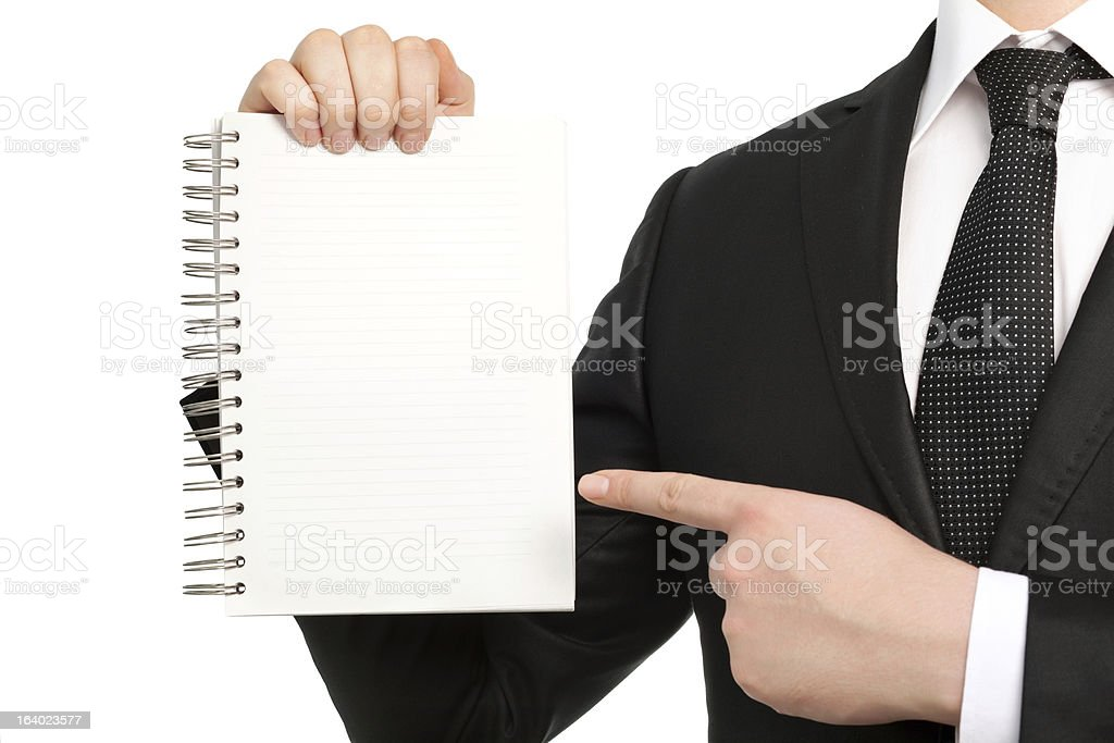 isolated businessman in suit and tie, holding a notebook royalty-free stock photo