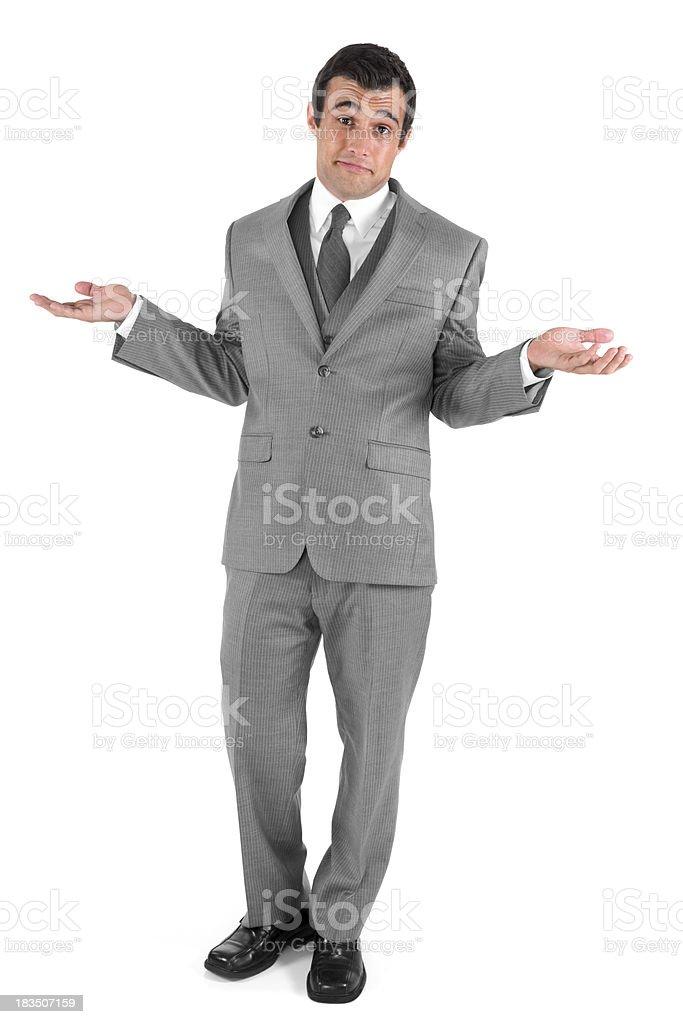 Isolated businessman shrugging royalty-free stock photo