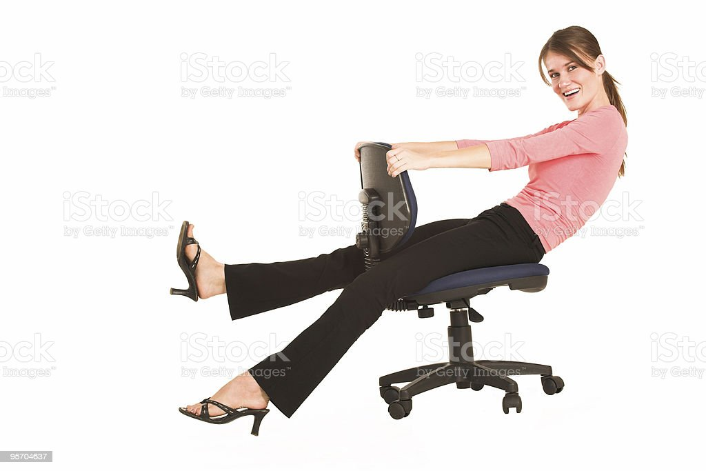 Isolated businesswoman sitting on office chair royalty-free stock photo